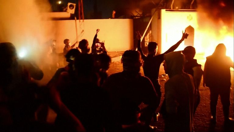 Iraqi protesters stormed the Iranian consulate in the southern city of Najaf and set fire to the building.