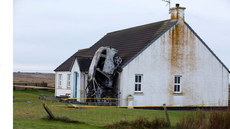 A car smashed into a house on the Isle of Lewis in Scotland. Pic: Sandie Photos