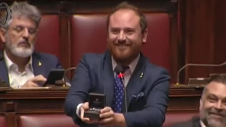 An Italian politician made a surprise proposal to his girlfriend while speaking in the Chamber of Deputies.