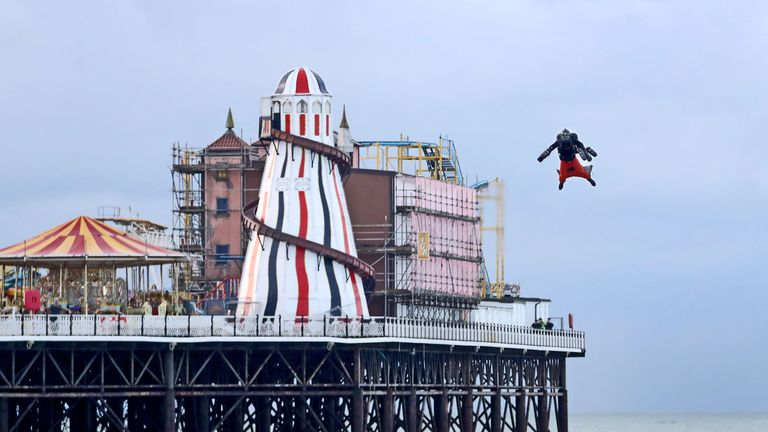 Richard Browning attempts to break his own Guinness World Record for the fastest speed in a body-controlled jet engine powered suit near Brighton Pier