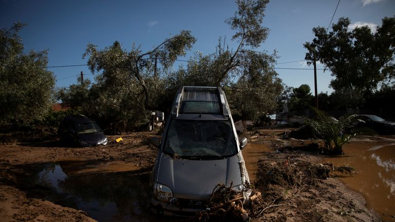 Damaged cars are seen following floods in the town of Kineta, Greece,