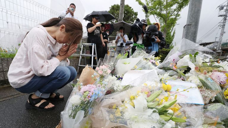 Relatives and anime fans left flowers at the offices in Uji, Kyoto prefecture, after the attack