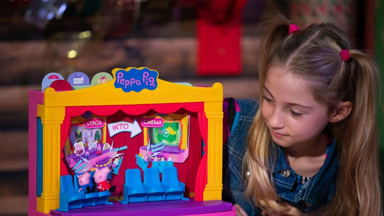 Liana Pierce, 7, plays with a Peppa Pig Peppa's Stage playset, which was named in the top 12 to buy