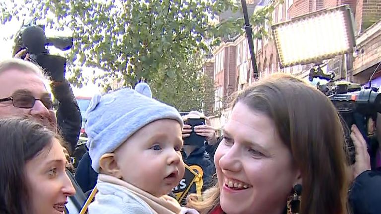 Leader of the Liberal Democrats Jo Swinson holds three month old San Skinner as she attends an election campaign event in Golders Green.