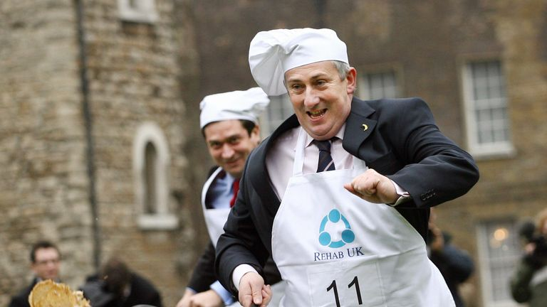 Sir Lindsay Hoyle takes part in a parliamentary pancake race