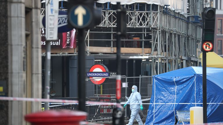 Forensic personnel at the cordoned off area around London Bridge in central London
