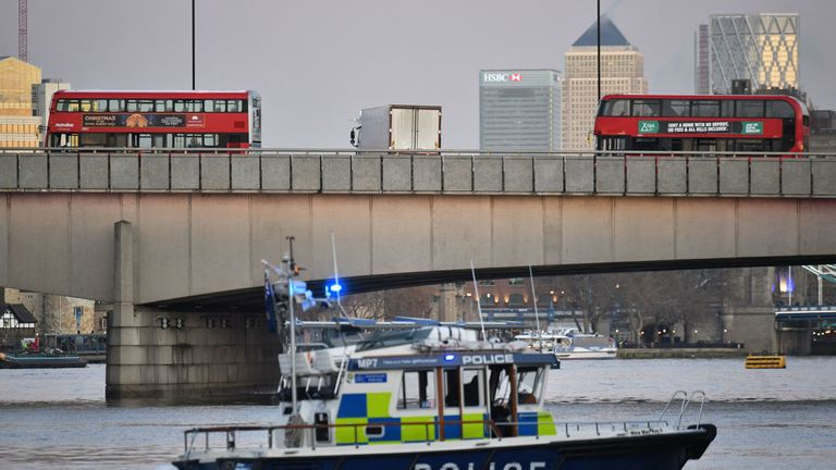 A police boat patrols along the River Thames after the suspect was shot dead