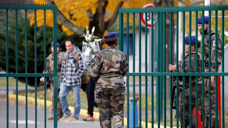 French soldiers arrives with flowers at the 5th Combat Helicopter Regiment base in Uzein near Pau, France