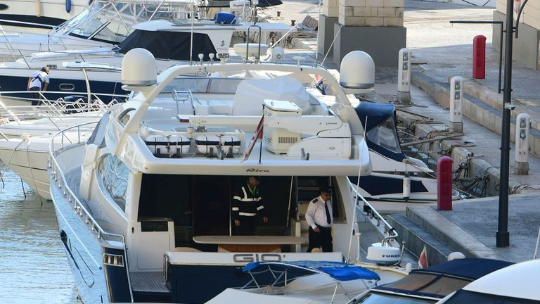 "Police aboard the yacht ""Gio"" after it was intercepted on a course for Sicily by the Maltese military and forced back to Portomaso, Malta. Authorities arrested owner and prominent businessman Yorgen Fenech. No details of the charges have been revealed, but authorities would have 48 hours to decide on them"