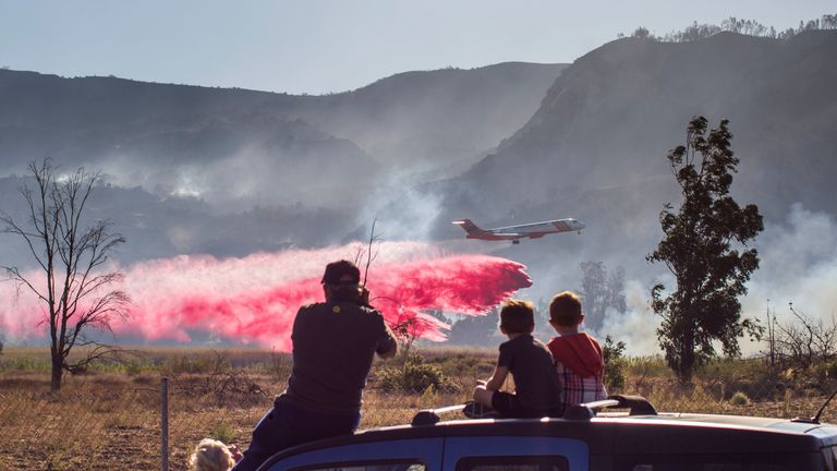 An Air Tanker drops fire retardant over the Maria fire