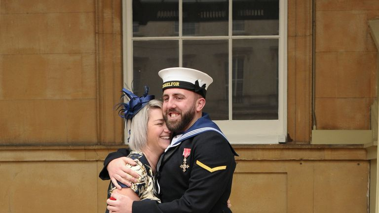 Matthew Gallimore and Adele Thomasson celebrate after getting engaged at Buckingham Palace