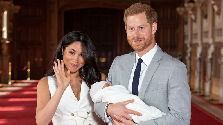 The duke and duchess pose with the newborn son in May