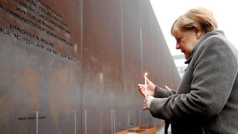 German Chancellor Angela Merkel lights a candle