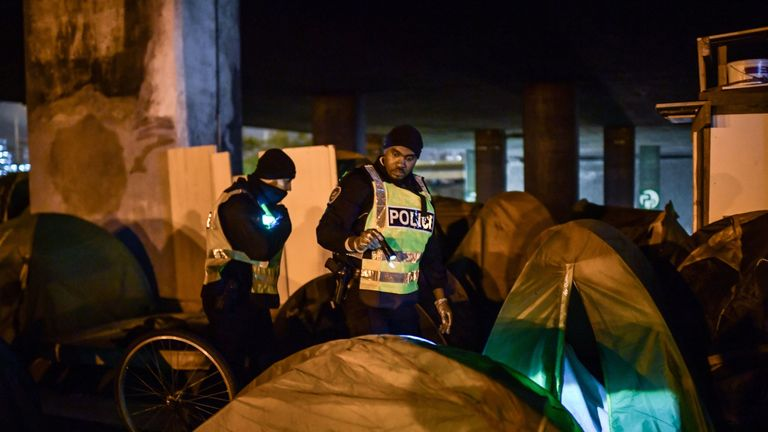 Migrants are moved on by French police