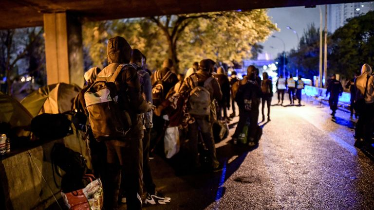 Police remove 1,600 migrants from camps under Paris flyovers