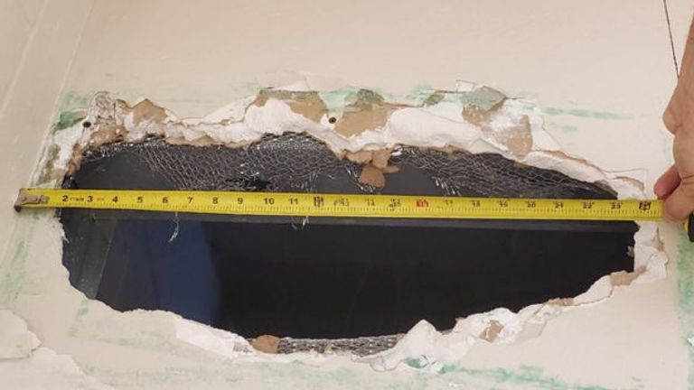 The pair made this 22in hole in a bathroom ceiling. Pic: Monterey County Sheriff