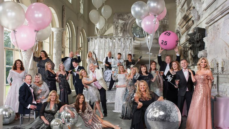 25 winners from each year of the lottery's existence posing for a Vanity Fair-style photo shoot. Pic: Sven Arnstein/The National Lottery