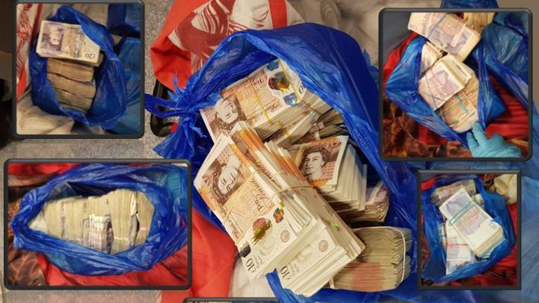 Cash recovered during early morning raids from seven home addresses