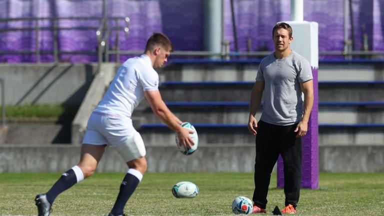 Jonny Wilkinson looks on as England captain Owen Farrell drop kicks the ball