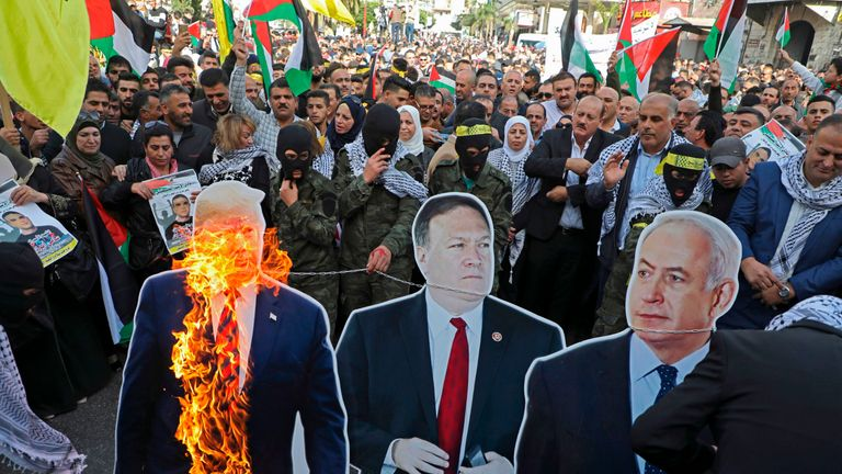 US President Donald Trump, State secretary Mike Pompeo and Israeli Prime Minister Benjamin Natanyahu card board cut outs are burnt