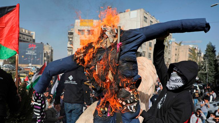 An effigy of Donald Trump is set on fire by Palestinians