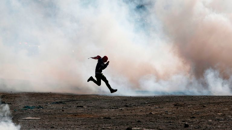 Palestinian demonstrators clash with Israeli security forces