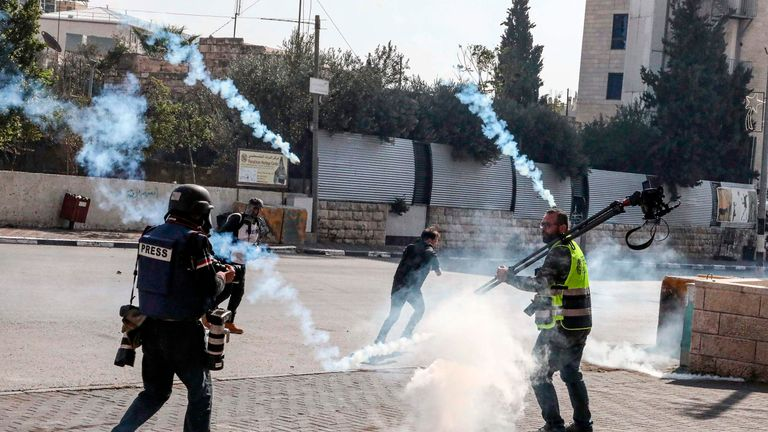 Tear gas fumes are fired during a demonstration by Palestinian journalists alongside Bethlehem in the occupied West Bank