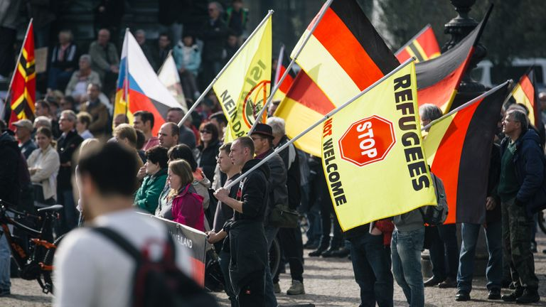 Supporters of the anti-immigrant PEGIDA movement demonstrate in Dresden in 2016