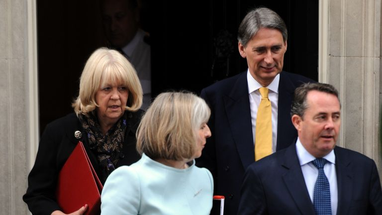 Welsh Secretary Cheryl Gillan, Home Secretary Theresa May, Transport Secretary Philip Hammond and Defence Secretary Liam Fox leave the new coalition Government's first cabinet meeting at 10 Downing Street, London.