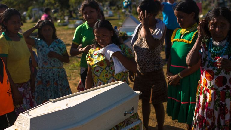A family in Brazil say goodbye to their 10-month-old relative who died from pneumonia