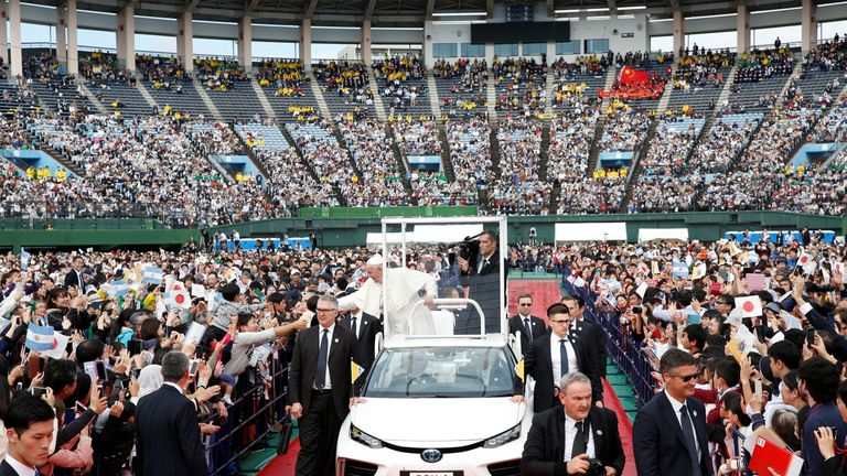 Pope Francis greets wellwishers from his Popemobile during a Holy Mass in Nagasaki