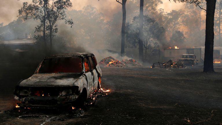 A vehicle burns in Possum Brush, south of Taree