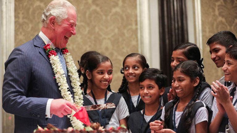 Prince Charles, who is in Mumbai, India, shared a chocolate birthday cake with schoolchildren to celebrate his birthday