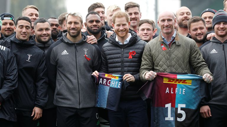 Prince Harry flanked by former England rugby captain Chris Robshaw (left) and former Wales rugby captain Gareth Thomas, often known as 'Alfie', (right)