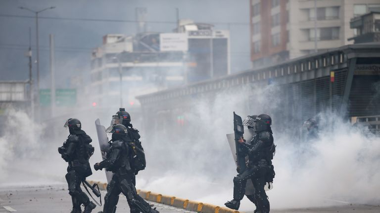 Riot police officers walk amid tear gas during a protest in Bogota, Colombia, November 21, 2019. REUTERS/Luisa Gonzalez
