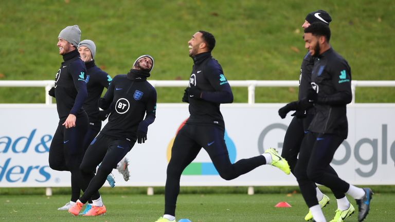 Raheem Sterling, (3rd left) and Joe Gomez (right) enjoyed a joke with team mates during training on Tuesday