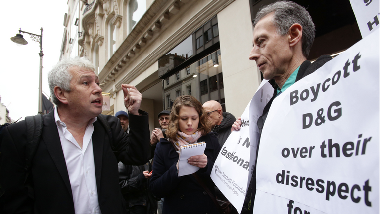 Journalist Rod Liddle (left) talks to Peter Tatchell during the Out and Proud Diamond Group and the Peter Tatchell Foundation taking part in a protest outside the flagship Dolce & Gabbana store on Old Bond Street, central London, following their comments on same-sex families and the use of fertility treatment.