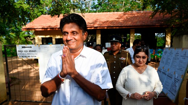 Presidential candidate Sajith Premadasa emerges after casting his vote
