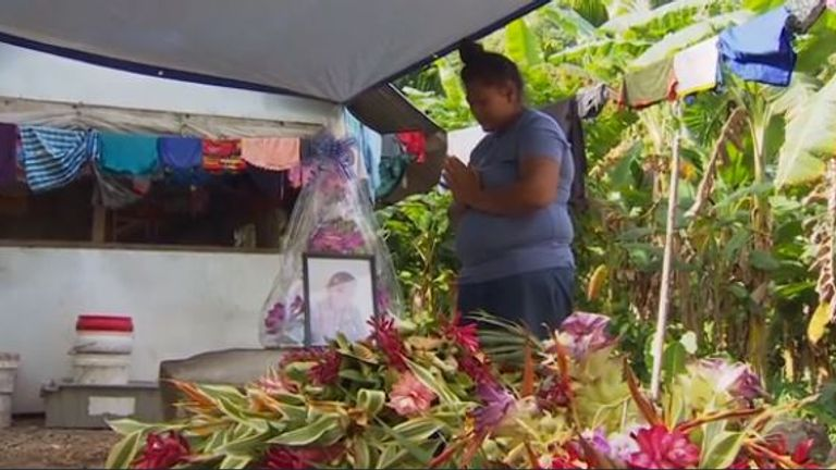 A mother mourns for her child who died from measles