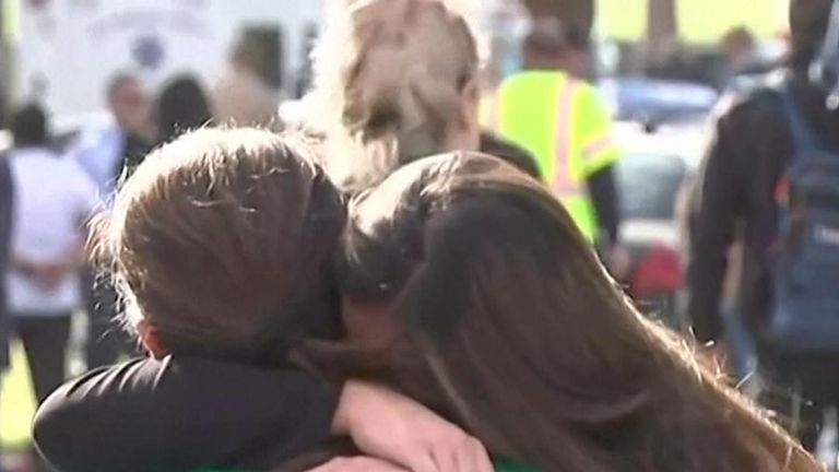 Parents and children reunite at Saugus High School in Santa Clarita, Los Angeles County