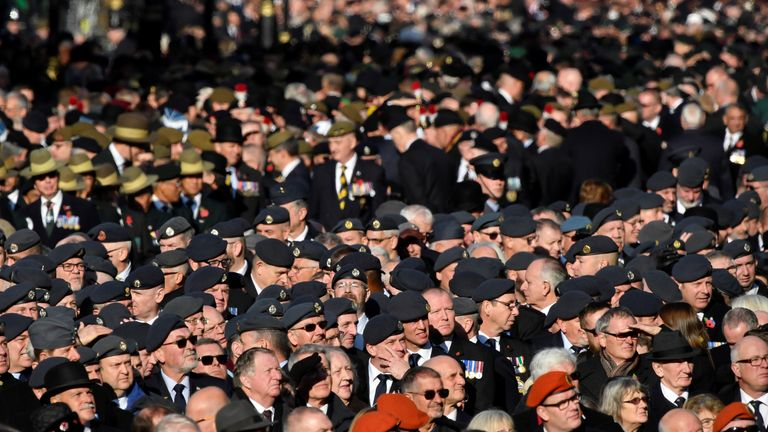 People attend a service of remembrance at the Cenotaph