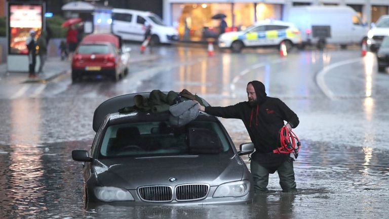 A man with car in a flooded street Sheffield, after torrential rain in the area. PA Photo. Picture date: Thursday November 7, 2019. See PA story WEATHER Rain. Photo credit should read: Danny Lawson/PA Wire