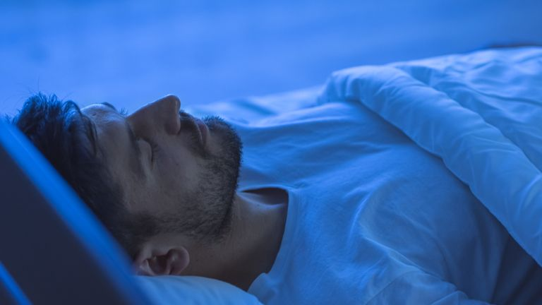 The man sleeping in the bed. night time stock photo