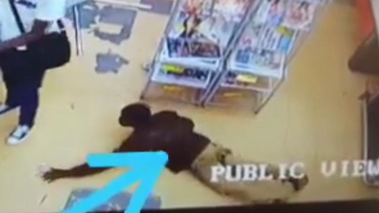 The video appears to show a customers taking the robber's loot. Pic: Intelligence Bureau SA