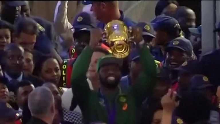 South Africa fans gathered at OR Tambo International Airport to give their World Cup-winning squad a rapturous welcome. Pic: AP