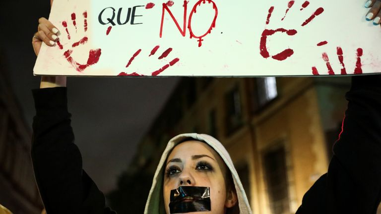 Protesters gesture during a demonstration against a Spanish court which sentenced five of six men accused of gang-raping a 14-year-old girl to 10 to 12 years in prison for sexually abusing the minor, but acquitted them of rape, outside the Justice Ministry in Madrid, Spain November 4, 2019. REUTERS/Sergio Perez