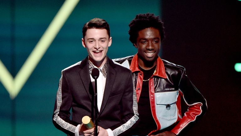 Noah Schnapp and Caleb McLaughlin accept The Show of 2019 award for 'Stranger Things' on stage during the 2019 E! People's Choice Awards. Pic: E! Entertainment
