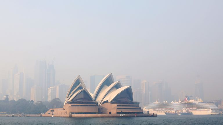 Smoke shrouds the Sydney Opera House on November 21, 2019 in Sydney, Australia. Most of NSW remains under severe or very high fire danger warnings as more than 50 fires continue to burn across the state
