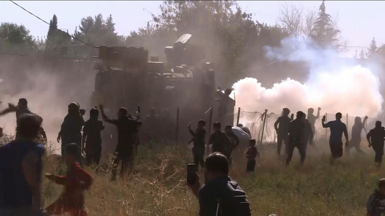 A Syrian protester has died after a group of protesters clashed with a convoy of Turkish and Russian military in Syria.