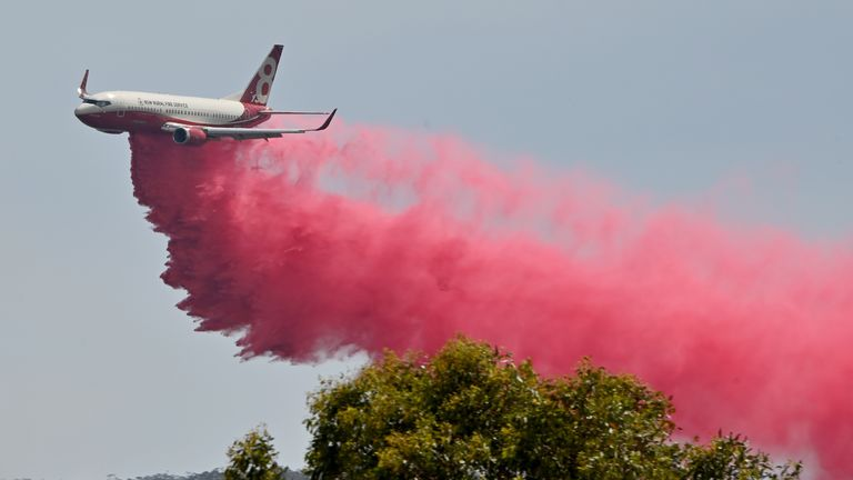 A Rural NSW Fire Service plane drops fire retardant on an out of control bushfire near Taree, 350km north of Sydney on November 12, 2019